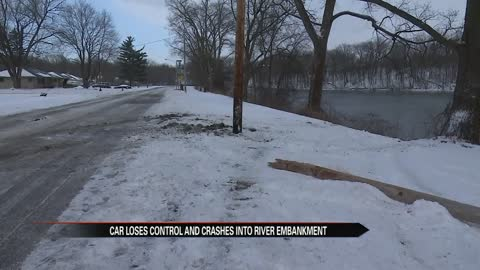 Witness recounts car sliding onto St. Joseph river bank